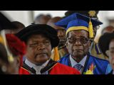 Robert Mugabe attends graduation in first appearance since military takeover